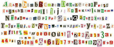 Newspaper alphabet. With numbers and symbols, isolated on white Royalty Free Stock Photo