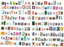 Newspaper alphabet - Upper Case. Many fonts (upper case) against a white background, which were cut from newspapers and magazines Royalty Free Stock Photography