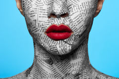Newspaper on beautiful Face Stock Photography