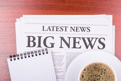 The newspaper  BIG NEWS  and coffee Stock Photos