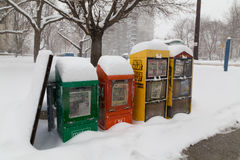 Newspaper Bins in the Snow in Toronto Royalty Free Stock Image