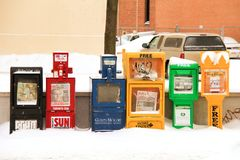 Newspaper box left outside. During winter time and lots of snow everywhere royalty free stock images