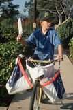 Newspaper boy on delivery papers. Newspaper delivery boy on bicycle, Los Angeles, California Royalty Free Stock Photography