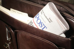 Newspaper in Briefcase. This is a close up image of a newspaper in a leather brief case stock photography