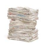 Newspaper bundles on a white background. Stacked newspaper bundles on a white background stock image