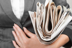 Newspaper about business close-up in hand Stock Photos