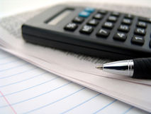 Newspaper, calculator and pen Royalty Free Stock Photos