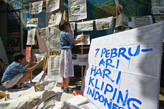Newspaper clippings. Learners make the work of newspaper clippings in Central Java, Indonesia Royalty Free Stock Photo