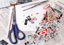 Newspaper clippings alphabet with letters. Numbers and symbols with scissors Stock Photography