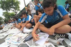 Newspaper Clippings. Hundreds of children participated in the mass clippings in Solo, Java, Indonesia. This activity in the march love reading to educate the Stock Photos
