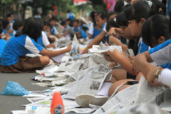 Newspaper Clippings. Hundreds of children participated in the mass clippings in Solo, Java, Indonesia. This activity in the march love reading to educate the Royalty Free Stock Photography