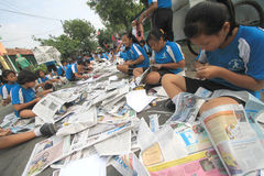 Newspaper Clippings. Hundreds of children participated in the mass clippings in Solo, Java, Indonesia. This activity in the march love reading to educate the Stock Photography
