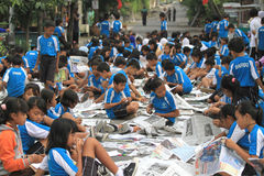 Newspaper Clippings. Hundreds of children participated in the mass clippings in Solo, Java, Indonesia. This activity in the march love reading to educate the Royalty Free Stock Image