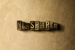 NEWSPAPER - close-up of grungy vintage typeset word on metal backdrop Stock Photos