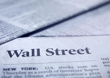 Newspaper closeup. Closeup of a newspaper with catchwords Wall Street and New York stock images