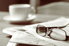 Newspaper and Coffee Stock Images
