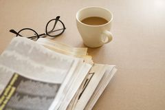 Newspaper with coffee on brown background stock images