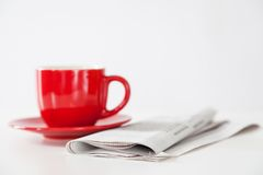 Newspaper and a coffee cup Stock Photo