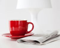 Newspaper and a coffee cup Stock Images
