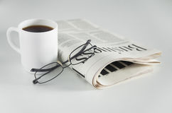 Newspaper, coffee and glasses Stock Photo