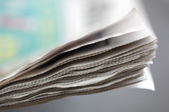 Newspaper. Concept edge of  pages with shallow depth of field Royalty Free Stock Photo