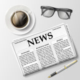 Newspaper with a cup of coffee and glasses on the table. Morning Royalty Free Stock Images