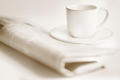 Newspaper and a cup of coffee Stock Image