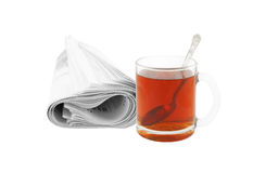Newspaper and cup of tea Royalty Free Stock Images