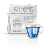 Newspaper with cup of tea Stock Images