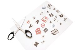 Newspaper cutting alphabet. Isolated over white, macro Royalty Free Stock Images