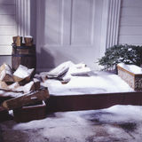 Newspaper delivery on winter porch Royalty Free Stock Photography