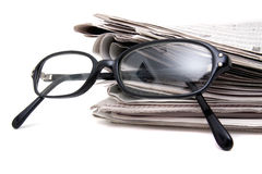 Newspaper and eye glasses Stock Photography