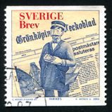 Newspaper and fictitious Postmaster of Gronkoping. SWEDEN - CIRCA 2002: stamp printed by Sweden, shows Newspaper and fictitious Postmaster of Gronkoping, circa Royalty Free Stock Photos