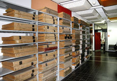 Newspaper files are on the shelves in the storage library Stock Image