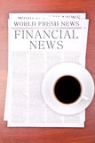 Newspaper FINANCIAL NEWS. And cup of coffee top view Stock Images