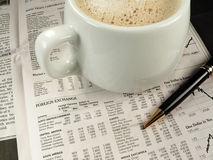Newspaper Financial Section. A morning office workspace with the financial section and a latte Stock Photo
