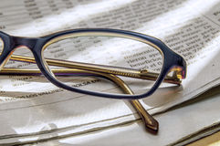 Newspaper and glasses 1. Newspaper full of interesting news and reading glasses Stock Images