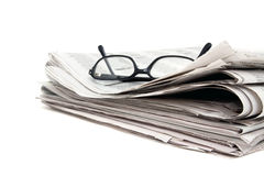 Newspaper and glasses royalty free stock image