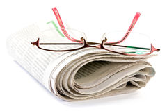 Newspaper with glasses Royalty Free Stock Photos