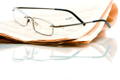 Newspaper and glasses Royalty Free Stock Photo
