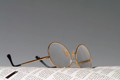 Newspaper and glasses Stock Images