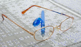 Newspaper and glasses. The newspaper focussed from front to back Royalty Free Stock Images