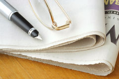 Newspaper, Glasses and Pen royalty free stock image