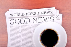 Newspaper GOOD NEWS. And cup of coffee top view Royalty Free Stock Photo