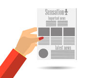 Newspaper in hand. Important news read in a newspaper. Royalty Free Stock Photos