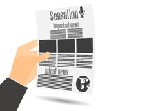 Newspaper in hand. Newspaper template. Important news read in a newspaper. Royalty Free Stock Image