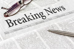 Newspaper with the headline Breaking News. A newspaper with the headline Breaking News Royalty Free Stock Image
