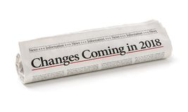 Newspaper with the headline Changes coming in 2018. Rolled newspaper with the headline Changes coming in 2018 Stock Image