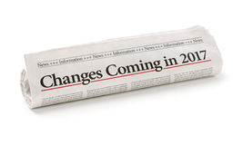 Newspaper with the headline Changes coming in 2017. Rolled newspaper with the headline Changes coming in 2017 Royalty Free Stock Photos