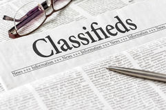 Newspaper with the headline Classifieds Royalty Free Stock Photo